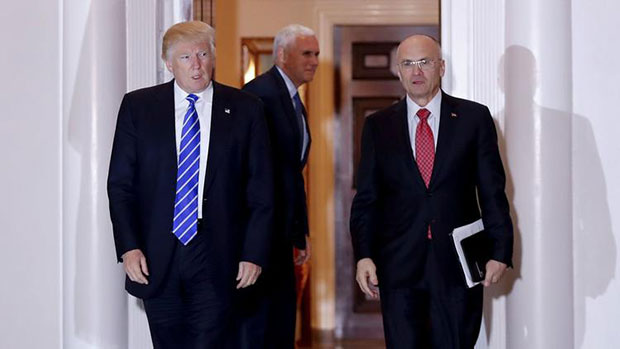 President-elect Donald Trump and Andy Puzder, nominee for secretary of Labor, leave the clubhouse of a Trump golf course in New Jersey. (Carolyn Kaster / Associated Press)